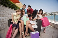 Group of friends with shopping bags posing