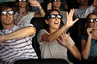 Audience enjoying 3_D movie in theater