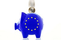 EU piggy bank and a falling one-euro coin, symbolic image for increasing the EU rescue fund