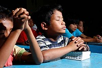 Children praying, Gelora Kasih orphanage, Kabanjahe, Batak region, Sumatra, Indonesia, Southeast Asia