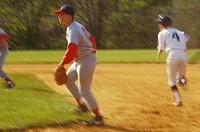 High School Baseball Game. Runner Taking Lead Off Base