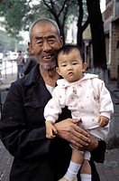 China, Luoyang. Grandfather Holding Baby