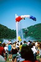 Pennsylvania, Pittsburgh. Crowd Watching Parachutist Landing.