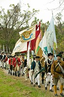 Patriot soldiers with flags march to Surrender Field as part of the 225th Anniversary of the Victory at Yorktown, a reenactment of the siege of Yorkto...