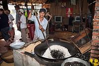 Vietnamese man making rice popcorn, Cuu Long, Cai Be, Mekong Delta, Vietnam