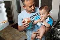 Father and son at home with yogurt