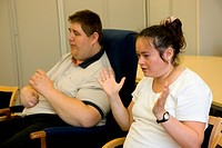Day Service users with learning disabilities using makaton a way of communicating with signs and symbols specially for people with learning difficulti...