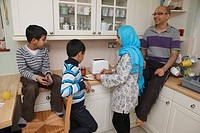 Asian family in kitchen