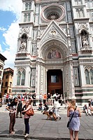 Tourists in front of the facade of Santa Maria del Fiore cathedral, Piazza del Duomo, Florence, Italy