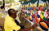 Ein Kunstmaler auf der Halbinsel Samana an der Karibik in der Dominikanische Republik.