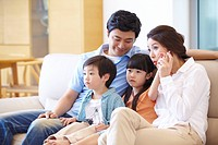 Portrait Of Family Watching Tv