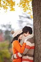 Young Couple In A Park In Autumn