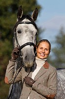 Lippizan Horse, Lippizaner Equus ferus caballus. The four year old stallion Diamant with woman rider