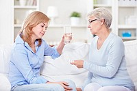 Mature woman gives a young woman pills