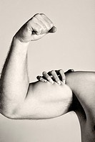 Man´s arm with female hand