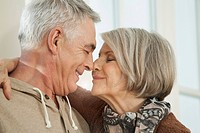 Germany, Berlin, Senior couple rubbing noses, smiling