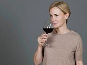 Mature woman drinking wine