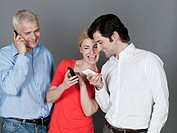 Men and woman using mobile phone