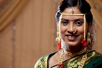 Portrait of beautiful young bride smiling