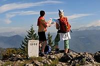 Female hikers on their way to lake Taubensee, Reit im Winkl, Chiemgau, Bavaria, Germany, Europe