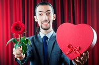 Young man with red rose