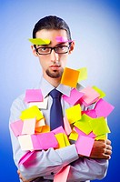 Young businessman with reminder notes