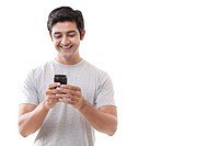 Handsome young man smiling white reading text message