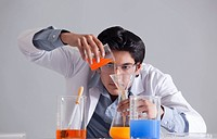 Scientist pouring liquid into flask