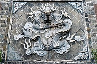 Chinese ancient rock art of dragon carvings
