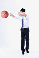 A man passing a basketball