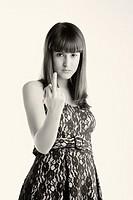 Girl lifting the ring finger