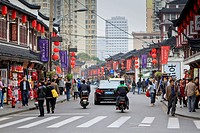 China, Shanghai, Pedestrians and traffic on Shanghai Old Street, one of last remaining traditional chinese districts in Shanghai, Fuxing