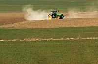 heavy tractor working on a field in Lower Saxony, Germany, near Goslar.