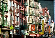 USA, New York, New York City, Row of colorful apartments and businesses lining Mott Street