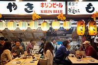 Tourists at a traditional outdoor restaurant, Yurakucho, Ginza, Tokyo, Japan