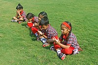 Pre Primary Students doing Exercise on Ground, India
