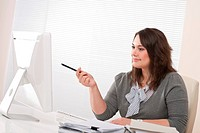 Young business woman working with computer at office