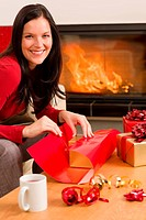 Christmas wrap present happy woman home fireplace