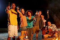 Friends having beach party at night