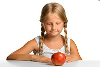 The pretty girl wishes to eat an apple