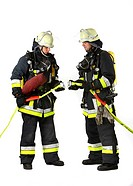 Firefighters from a fire-fighting crew wearing breathing equipment connecting two c-hoses, professional firefighters from the Berufsfeuerwehr Essen, E...