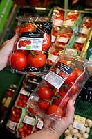 Pack of organic tomatoes, food hall, supermarket, Germany, Europe