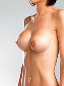Cropped image of a shirtless young womans bare breasts