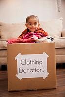 Caucasian boy donating clothing