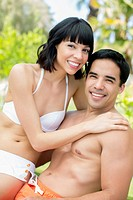 Couple hugging outdoors in bathing suits