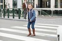 Schoolgirl crossing a road