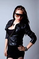 Beautiful grunge sexy woman in leather jacket