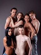 group of sexy young nude people posing in jeans
