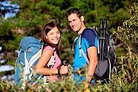 Happy hiking couple smiling