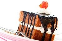 A piece of chocolate cake with vanilla cream